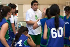 A coach gives advice to the basketball players. Royalty Free Stock Photo