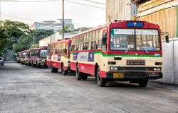 BANGKOK, THAILAND - NOVEMBER 14: Rundown free fare buses by Bang. Kok Mass Transit Authority lined up in the morning before daily operation in Bangkok, on Stock Image