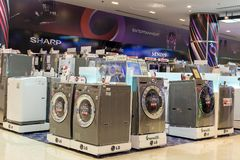 Sale of washing machines in the supermarket of various manufacturers in Siam Paragon Mall, Bangkok, Thailand. BANGKOK,THAILAND - NOVEMBER 19, 2013 : Sale of Stock Images