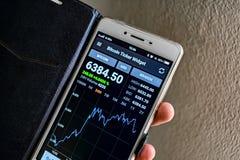 BANGKOK, THAILAND - NOVEMBER 01: Smartphone displays exchange ra royalty free stock image