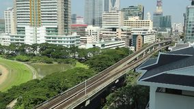 BTS Skytrain going opposite directions, in and out from the station stock video footage