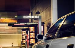 BANGKOK, THAILAND - NOVEMBER 04: A white car drives into a Mcdon Stock Photos