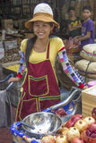 BANGKOK, THAILAND-OCT 26TH: A pomegranate juice vendor smiles fo Royalty Free Stock Photos