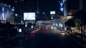 Bangkok, Thailand - 21 OCT 2017: Night Road traffic in BKK City Near Shopping Mall. 4K. Bangkok, Thailand - 21 OCT 2017: Night Road traffic in BKK City Near stock footage