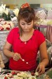 BANGKOK, THAILAND : OCT 12th: Girl making Buddhist Royalty Free Stock Photo