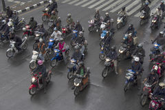 BANGKOK, THAILAND OCT 11TH: Motorcyclists wait at traffic lights Stock Photo