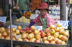 BANGKOK, THAILAND-October 10TH 2010: A woman sells pomegranate f Stock Images