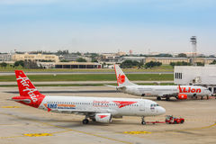 Bangkok, Thailand  - October 19 2014: AirAsia is a Malaysian low. BANGKOK, THAILAND - OCTOBER 19: AirAsia in Bangkok, Thailand on October 19, 2014. Malaysian low Stock Image