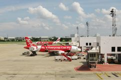 BANGKOK, THAILAND - OCTOBER 18, 2013: Aircrafts on airfield of airport Don Mueang. Stock Photos