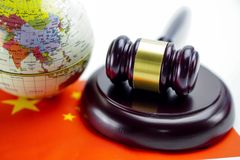 Bangkok, Thailand - October 1, 2018 China: Judge hammer on wold globe map. Law and justice court concept. Bangkok, Thailand - October 1, 2018 China : Judge stock photography