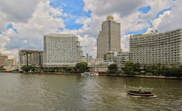 BANGKOK, THAILAND - OCTOBER 26, 2014. Daylight view from Taksin Bridge of Sathon District, Bangkok, Thailand. Below the bridge the Sathorn pier offers the Stock Image