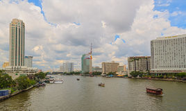 BANGKOK, THAILAND - OCTOBER 26, 2014:. Daylight view from Taksin Bridge of Sathon District, Bangkok, Thailand. Below the bridge the Sathorn pier offers the Stock Photography
