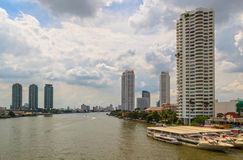 BANGKOK, THAILAND - OCTOBER 26, 2014:. Daylight view from Taksin Bridge of Sathon District, Bangkok, Thailand. Below the bridge the Sathorn pier offers the Royalty Free Stock Photography