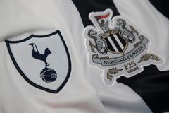 BANGKOK, THAILAND -OCTOBER 19: The Logo of Tottenham Hotspur  an. D Newcastle United football club on an official jersey on October 19,2017 Royalty Free Stock Photos