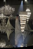 Fashion Show of Wedding dress and Evening Gown along Chandelier. Bangkok, Thailand - October 4, 2018 ; Model walks in Fashion Show of Wedding dress and Evening royalty free stock image