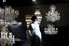 Fashion Show of Wedding dress and Evening Gown along Chandelier. Bangkok, Thailand - October 4, 2018 ; Model walks in Fashion Show of Wedding dress and Evening royalty free stock images