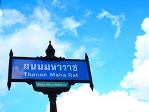 `Thanon Maha Rat` road sign, close up, with sky background stock photos
