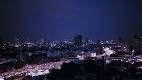 BANGKOK THAILAND - OCTOBER 21: View of Business Building Bangkok city area traffic location at night life, tracking high angle sho stock footage