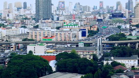 BANGKOK THAILAND - OCTOBER 21: View of Business Building Bangkok city area traffic location by panning with tracking high angle sh stock video footage