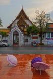 BANGKOK, THAILAND- OCTOBER 26, 2014:. Wat Suthat Thep Wararam after rain and umbrellas at the forground, Bangkok stock photography