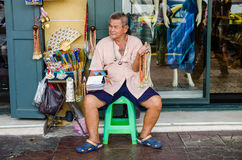 Bangkok, Thailand : Old man selling Stock Photos