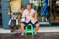 Bangkok, Thailand : Old man selling Stock Photos