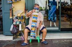 Bangkok, Thailand : Old man selling Stock Photography