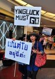 Bangkok, Thailand: Operation Shut Down Bangkok Protestor. Woman protestor holding political signs at Siam Center at the Operation Shut Down Bangkok Royalty Free Stock Photography