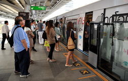 Bangkok, Thailand: Passengers Boarding Skytrain Royalty Free Stock Photos