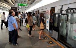 Bangkok, Thailand: Passengers Boarding Skytrain Royalty Free Stock Photos