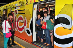 Bangkok, Thailand: Passengers on BTS Skytrain Royalty Free Stock Photos
