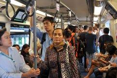 Bangkok, Thailand: Passengers Riding BTS Skytrain Stock Photo