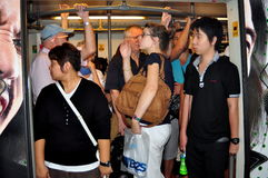 Bangkok, Thailand: People on BTS Skytrain Royalty Free Stock Images