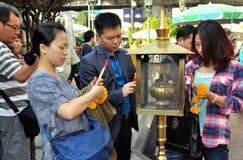 Bangkok, Thailand: People Lighting Incense Sticks Royalty Free Stock Photo