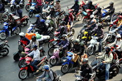 Bangkok, Thailand: People on Motorcycles Stock Image