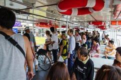 Bangkok, Thailand : People in passenger boat Stock Images