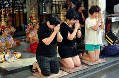 Bangkok, Thailand: People Praying at Erawan Shrine Royalty Free Stock Photos