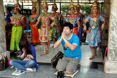 Bangkok, Thailand: People Praying at Erawan Shrine Stock Photo