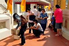 Bangkok, Thailand: People Praying at Temple Stock Photo
