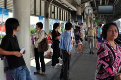 Bangkok, Thailand: People Waiting for Skytrain Royalty Free Stock Image