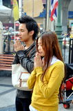Bangkok, Thailand: Praying Couple at Erawan Shrine Stock Images