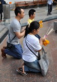 Bangkok, Thailand: Praying at the Erawan Shrine Royalty Free Stock Photography