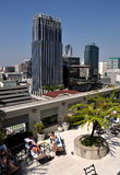 Bangkok, Thailand:  Rooftop Sunbathers and Skyline Stock Photography