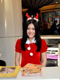 Bangkok, Thailand: Sales Clerk with Christmas Hat Royalty Free Stock Photo