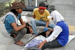 Bangkok, Thailand: Seated Workers Stock Photo