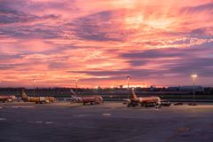 Bangkok, Thailand - Sep 06 2017 : Airplane parked in airport at beautiful sunset stock photos