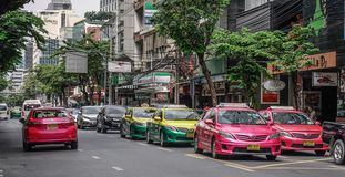 Taxis on street of Bangkok, Thailand stock photography