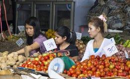 BANGKOK, THAILAND SEP 27TH: Customers at a vegetable stall  in K Royalty Free Stock Photo