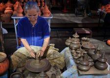 BANGKOK THAILAND - SEP21 :unidentified old woman making thai st stock photography