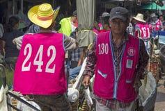 BANGKOK, THAILAND - SEPT 27TH: A porter makes his way through Kh Royalty Free Stock Images